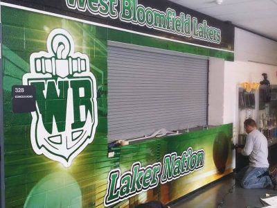 Installing Large Wall Mural At School